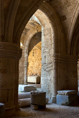 Rhodes Old City - Gothic arches in the courtyard of historic Knight hospital  today Archaeological Museum. Greece