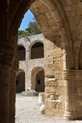Rhodes Old City - Hospital of the Knights of Saint John, the medieval open arcade. At present Archaeological museum. Dodecanese Islands, Greece