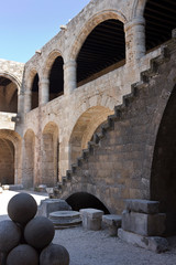 Rhodes Old City - Hospital of the Knights, the main courtyard. The outside stairway leads to the upper floor. Today Archaeological museum. Dodecanese Islands, Greece