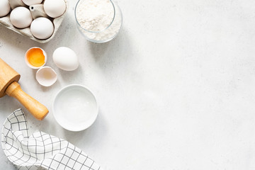 Baking Cooking Ingredients Flour Eggs Rolling Pin Butter And Kitchen Textile On Bright Grey Concrete Background. Top View Copy Space. Cookies Pie Or Cake Recipe Mockup Wall mural