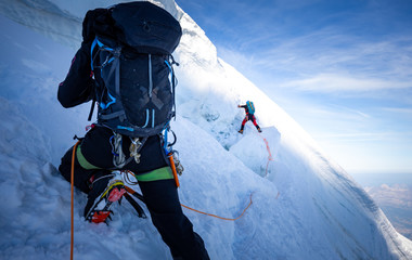 Two mountaineers climb steep glacier ice crevasse extreme sports, Mont Blanc du Tacul mountain, Chamonix France travel, Europe tourism.  Wall mural