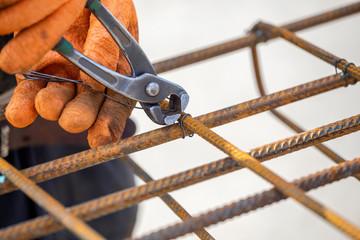 Tying reinforcing steel bars (rebar)