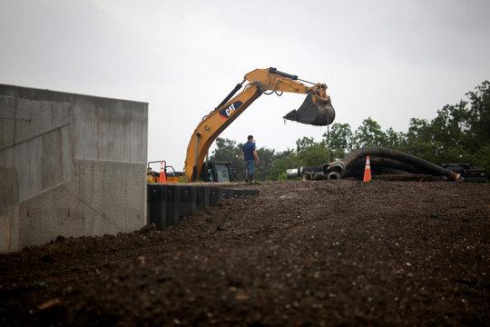 Crews work to set up water pumps during Hurricane Barry in Plaquemines Parish