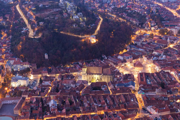 Brasov, Romania: Panoramic view of the city center from Tampa Mountain at dusk