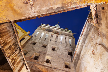Sighisoara, Romania: Clock Tower seen directly from below at dusk