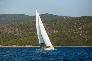 Fototapete - Sailing yacht boat at the Aegean Sea near the Greek shores.