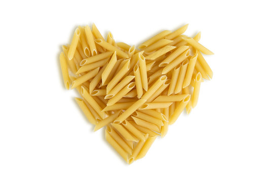 Pasta from durum varieties laid out in the shape of a heart and isolated on a white background. I love to cook