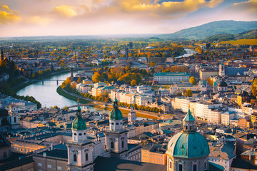 Spoed Fotobehang Wenen Beautiful of Aerial panoramic view in a Autumn season at a historic city of Salzburg with Salzach river in beautiful golden evening light sky and colorful of autumn at sunset, Salzburger Land, Austria