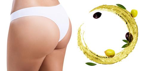 Female buttocks near swirl olive oil. Dieting concept.