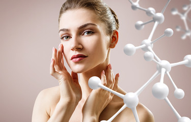 Beautiful young woman near big white molecule chain.