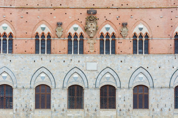 Fototapete - Exterior of Torre del Mangia in Piazza del Campo, Siena, Tuscany, Italy