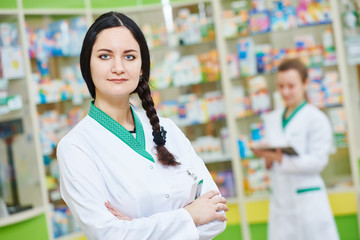 Female pharmaceutical worker portrait in drugstore