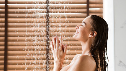 Woman Taking Shower Enjoying Water Splashing On Her