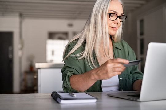 Mature woman doing online payment
