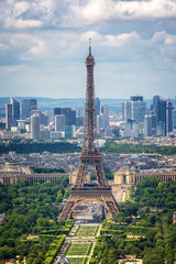 Wall Mural - Aerial view of Paris with the Eiffel tower and la Defense business district skyline, France and Europe city travel concept