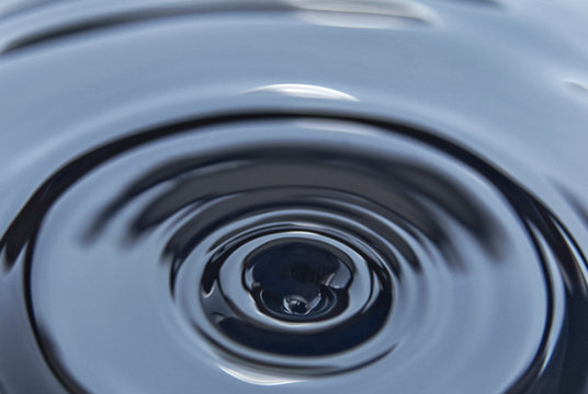 Splash on the black petroleum surface