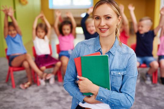 Portrait of smiling female teacher in the preschool