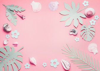 Wall Mural - Frame of sea shells and tropical leaves on pastel pink background, top view.  Creative layout. Flat lay. Summer concept