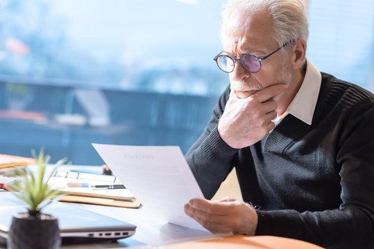 Senior businessman reading a document