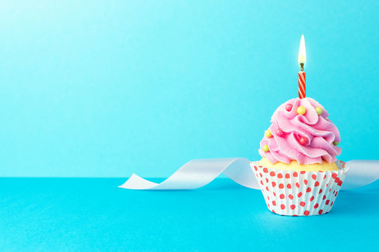 Colorful celebration background with cupcake. Minimal party concept.