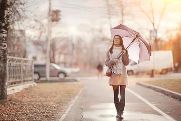 young woman umbrella autumn / autumn trendy look, model with umbrella, rainy cold weather