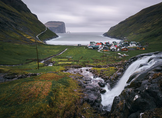 Wall Mural - Waterfall and the village of Tjornuvik in the Faroe Islands