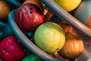 multicolored bowling balls in stack