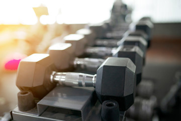 Close up black dumbbell set in sport fitness center , Weight Training concept.