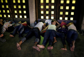 Central American migrants who returned to Mexico from the U.S. sleep outside the Our Lady of Guadalupe Cathedral in Ciudad Juarez