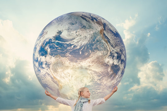 Girl holding the Planet Earth. Future Concept. Elements of this image furnished by NASA.