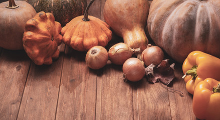 autumn pumpkins and other fruits and vegetables on wooden thanksgiving table