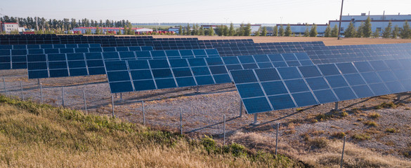 Solar Panel field with snow on panels. Photovoltaic power electrical station