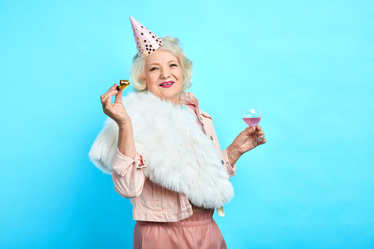 stylish smiling woman in funny clothes having fun on her Birthday. close up photo. isolated blue bacakground, lifestyle, free time