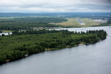 Storsandskar island in Ume river is pictured with Umea Airport in the background