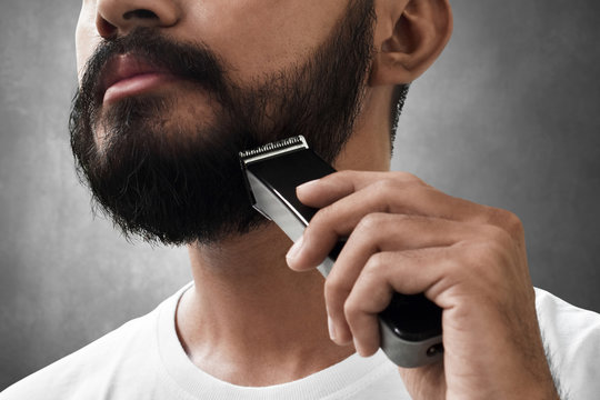 Bearded man shaving his beard