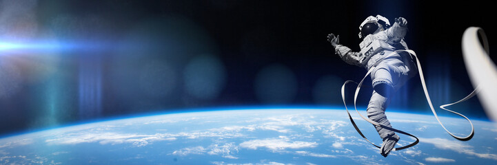 astronaut performing a spacewalk in orbit of planet Earth (3d illustration banner, elements of this image are furnished by NASA)