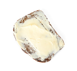 Slice of bread with butter isolated on white, top view