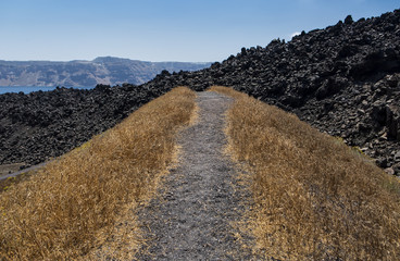 Grey landscape of Nea Kameni, volcanic island near Santorini, Greece.