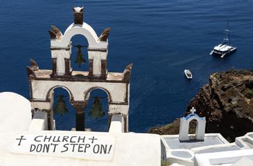 SANTORINI, GREECE - 19 JUNE 2019: Do not step on roof sign in village of Oia on Santorini.