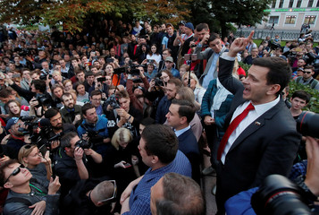 Russian opposition figure Ilya Yashin addresses his supporters during a rally in Moscow