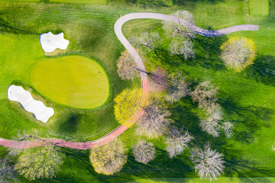 Aerial view of a golf course fairway and sand traps in early spring creating an abstract looking perspective at the Naperville Country Club in Napervile, IL - USA