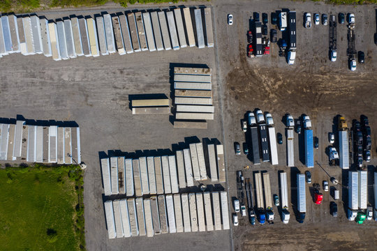 Aerial view of parked semi trucks and cars at a parking lot in Romeoville, IL - USA