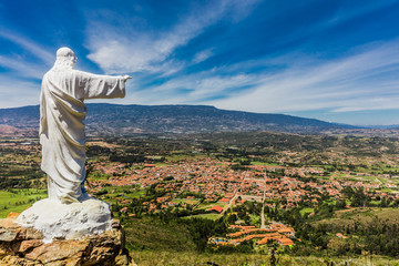 Fototapete - Mirador El Santo and his Jesus statue Villa de Leyva skyline cityscape Boyaca in Colombia South America