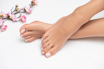 Perfectly done french pedicure on white background. Wall mural