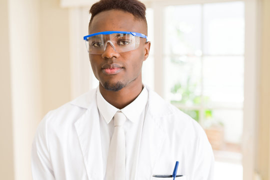 African young scientist man wearing safety glasses working with chemical equipment