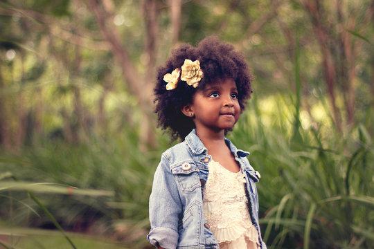 Portrait of little girl wearing flowers in her hair