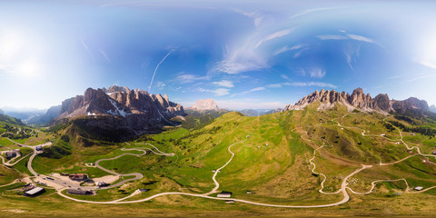 Aerial top 360 degree view to wonderful alpine landscape and meadows at Pass Gardena with majestic Sella mountain group in Dolomiti. Alps, South Tirol, Dolomites mountains, passo di Val Gardena, Italy Wall mural