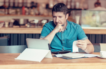 Owner of a Small business checking monthly reports bills and expenses of his Restaurant
