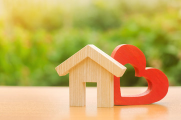 House with a red wooden heart. House of lovers. Parental hospitable home. Housing construction of your dreams. Buying and renting real estate. Affordable housing for young families, support program. Wall mural