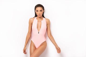 Sexy woman in pink swimwear posing.
